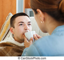 woman caring for unwell husband