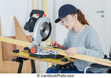 woman carpenter in wheelchair
