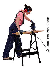 Woman carpenter using a jigsaw.