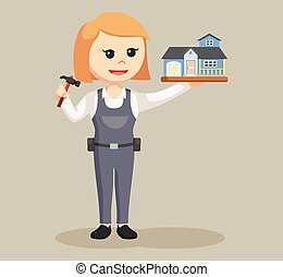 woman carpenter with house miniature