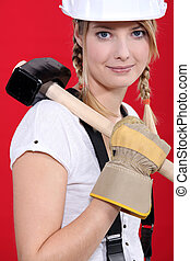 Woman carrying a mallet on her shoulder