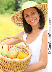 woman carrying fruits in basket