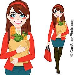 Woman Carrying Grocery Bag - Beautiful brunette young woman...