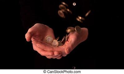 Woman catching falling euro coins