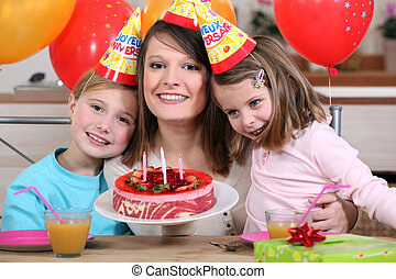 Woman celebrating a birthday with her kids