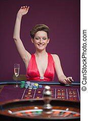 Woman celebrating at roulette