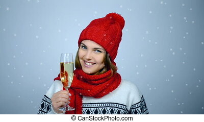 Woman celebrating Christmas or New Year with glass of champagn