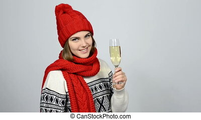 Woman celebrating Christmas or New Year with glass of champagne