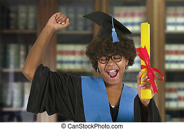woman celebrating graduation with diploma