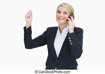 Woman celebrating on phone