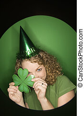 Woman celebrating St. Patty. - Vignette of young adult...