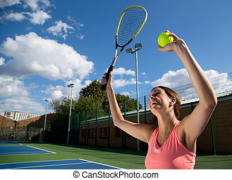 woman celebrating winning tennis match