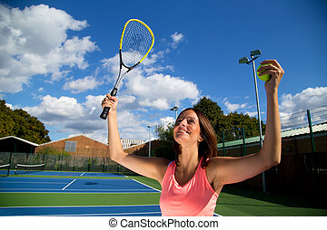 woman celebrating winning tennis match.