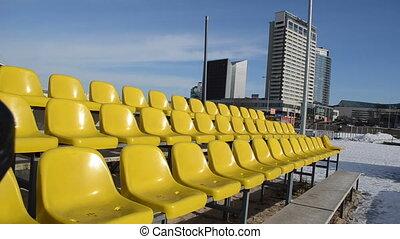 woman chair row plastic