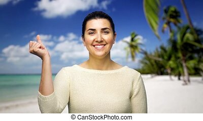 woman changing background image by finger snap - technology,...