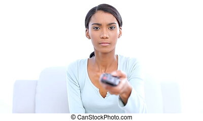 Woman changing tv channel on white background