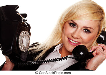 Woman chatting on an old fashioned telephone