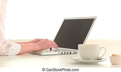 Woman chatting on her laptop
