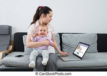 Woman Chatting On Social Networking Site Using Laptop