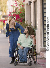 Woman Chatting with Man in Wheelchair