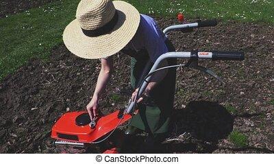Woman check cultivator