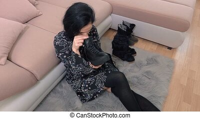 Woman checking  boots