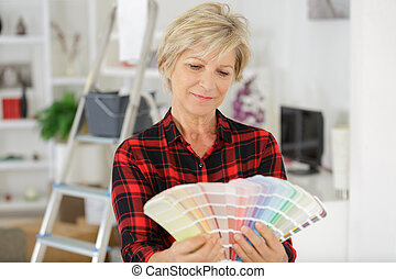 woman checking colour swatches