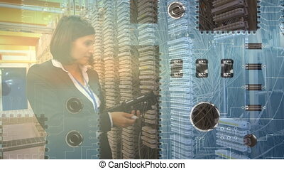 Woman checking equipment in a computer server room