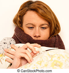 woman checking feaver with digital termomether girl with flu