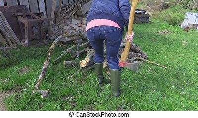 Woman checking firewood