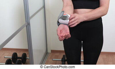 Woman checking heart-rate after workout.Healthy Lifestyle Concept