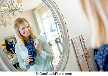 Woman checking her appearance in a mirror