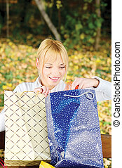 Woman checking out bag content