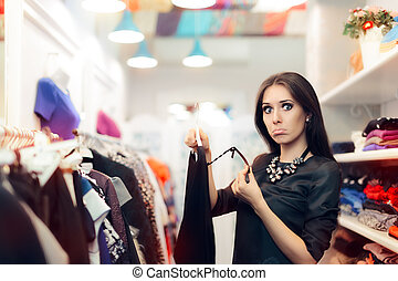 Woman Checking Price Tag - Fashion girl surprised by an...