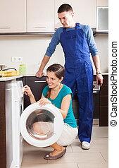 Woman checking repairman's work