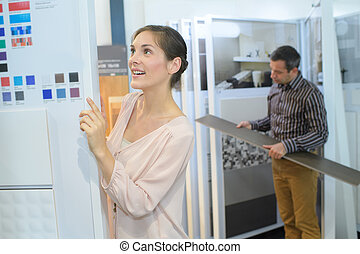 woman checks colours for a house