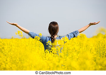 Woman cheering in the rape field