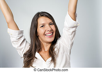 woman cheering with fists in the air - woman screaming...