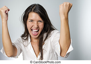 woman cheering with fists in the air