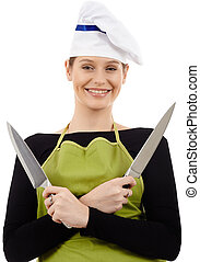 Woman chef holding knives
