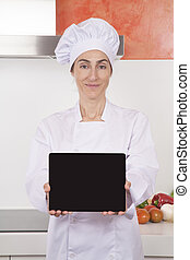 woman chef showing blank tablet