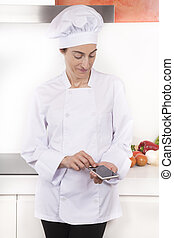 woman chef using screen blank phone