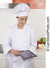 woman chef using tablet