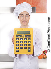 woman chef with calculator in hands