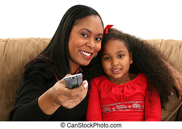 Woman Child Remote - Beautiful African American woman and...