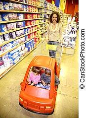 woman child supermarket