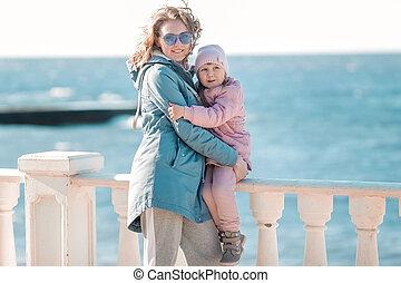 Woman Child Walk Seashore sunny Day Barefoot