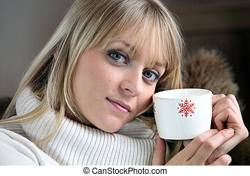 Woman chilling-out with coffee on sofa