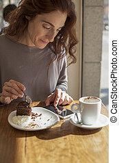 woman chocolate cake and phone