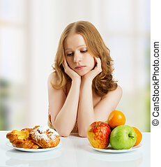 woman choose between healthy and unhealthy food - woman with...